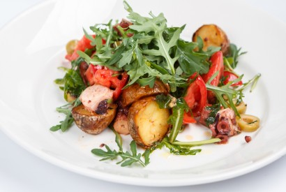 Octopus salad with potatoes and tomatoes