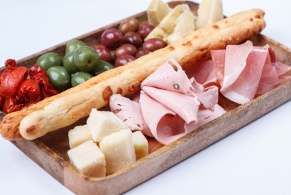 Italian appetizer: assorted sausages, cheeses, olives, artichokes