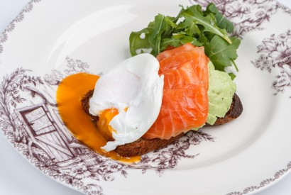 Poached egg with avocado and salmon on homemade bread
