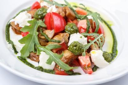Salad with eggpalnt, sweet tomatoes, mozzarella and pesto